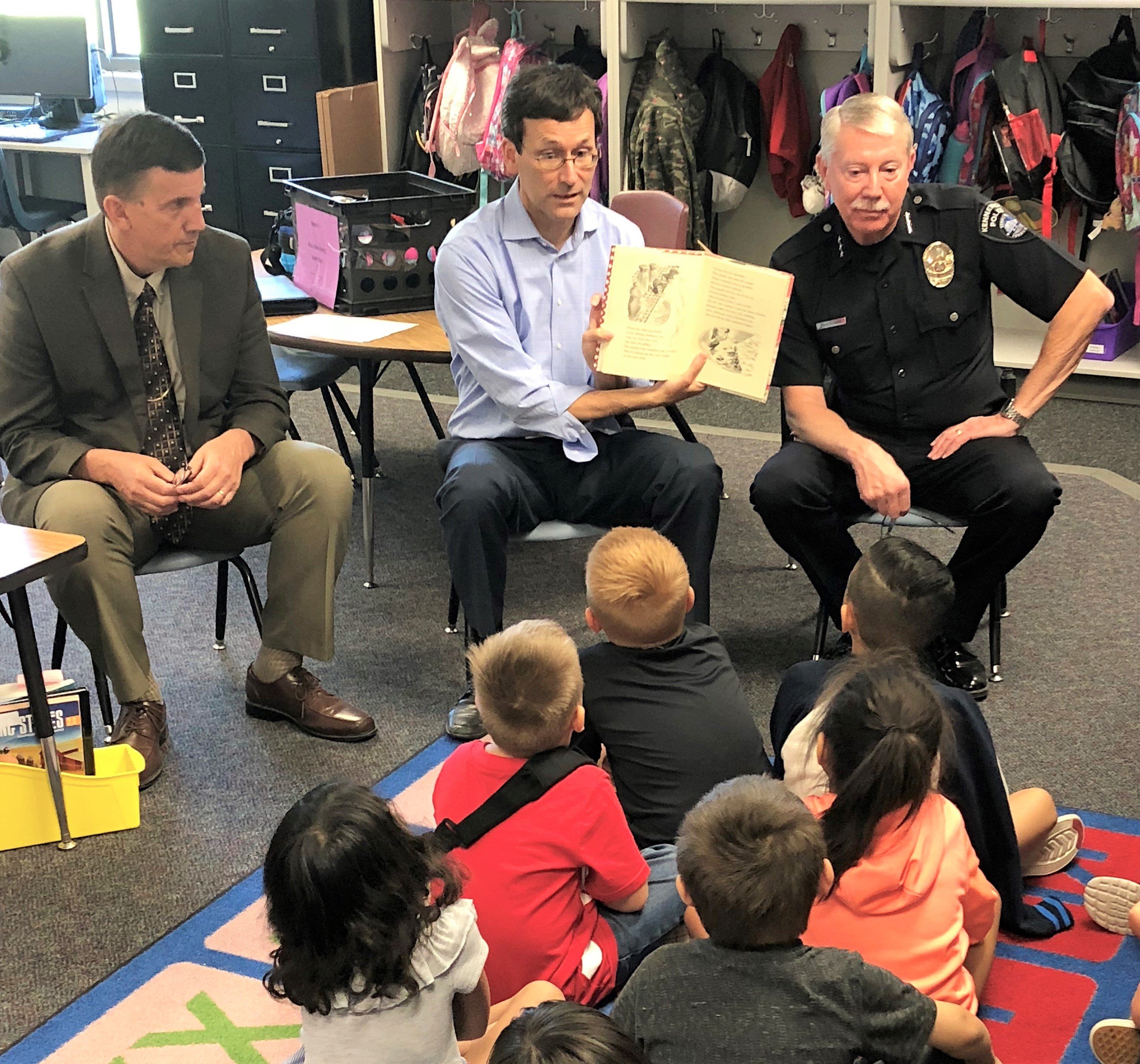 Attorney General Ferguson and other officials reading book to children