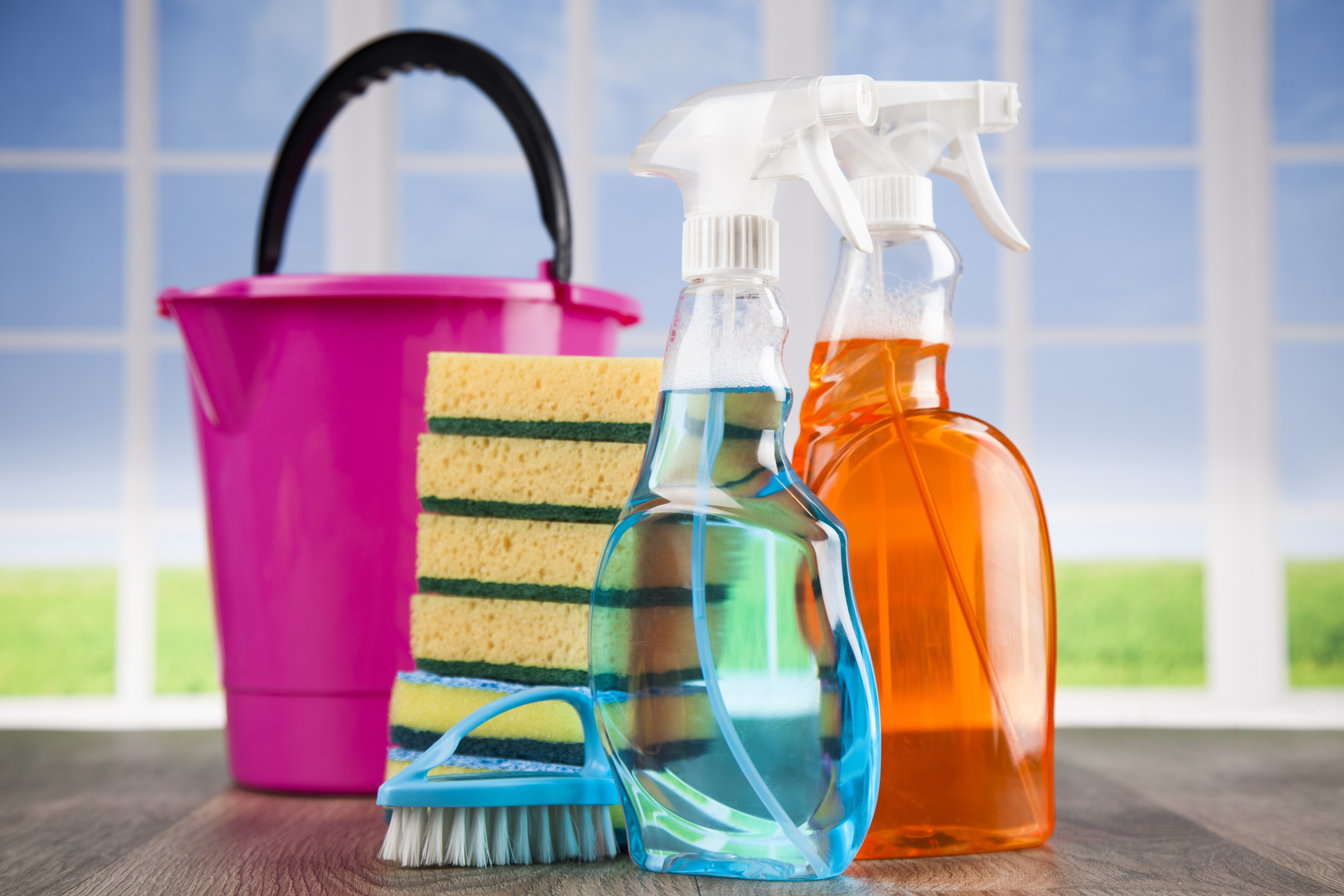 cleaning supplies - spray bottles with bucket and sponges