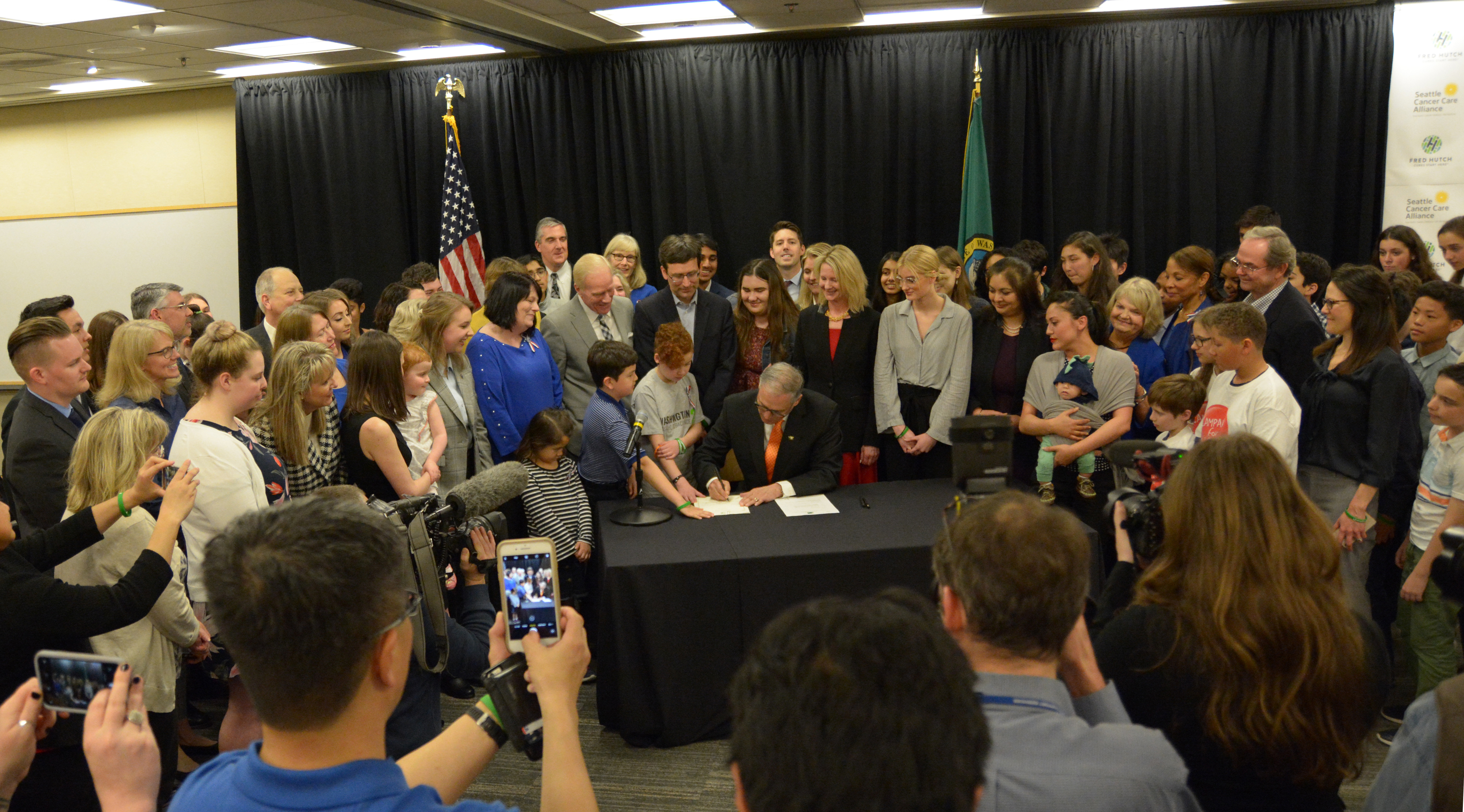 Gov. Jay Inslee signs AG Bob Ferguson's agency request legislation into law. The bill raises the age to purchase tobacco products in Washington from 18 to 21.