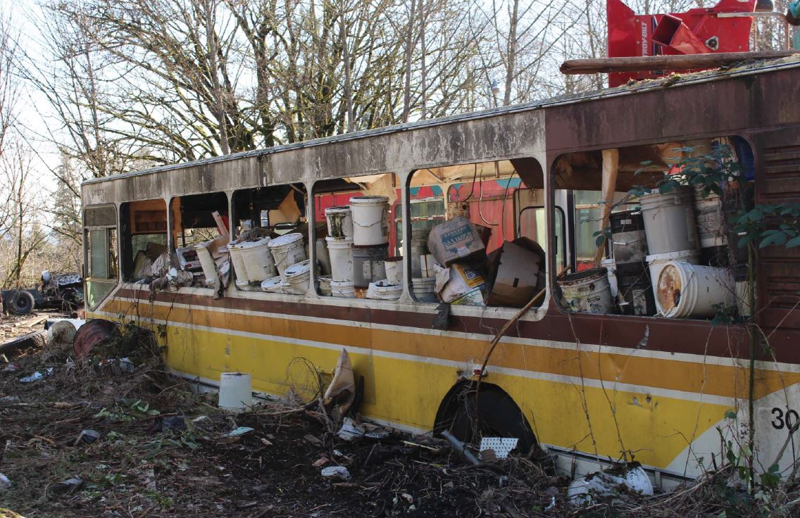 Decaying bus with buckets inside